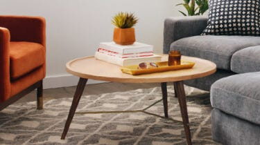 Interior Define Brooks walnut and oak coffee table in a living room setting