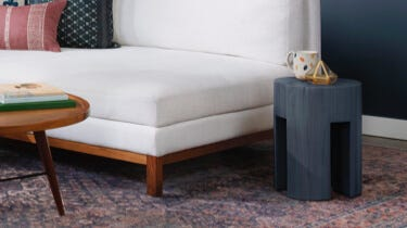 Interior Define Greer navy coffee table in a lounge setting